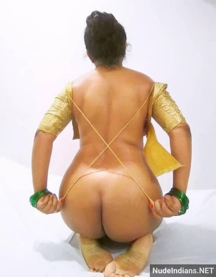 aunty nude stripping photo min